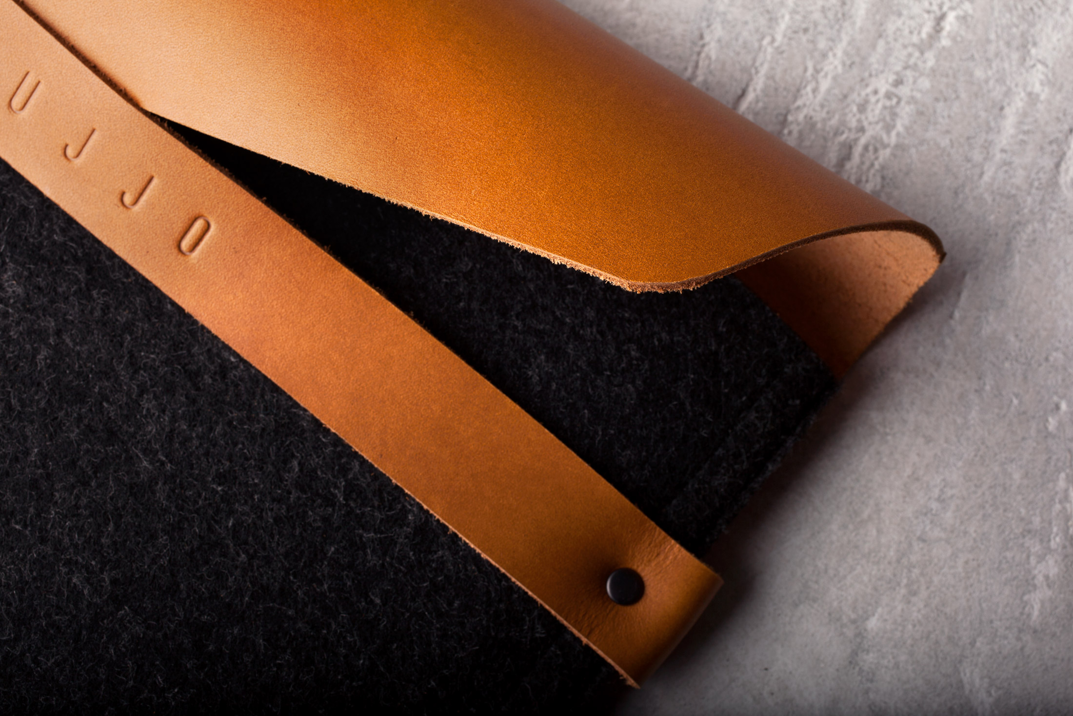 The new Mujjo iPad sleeve and iPhone wallet: Sophisticated gadget cases that can hold their own in any office.
