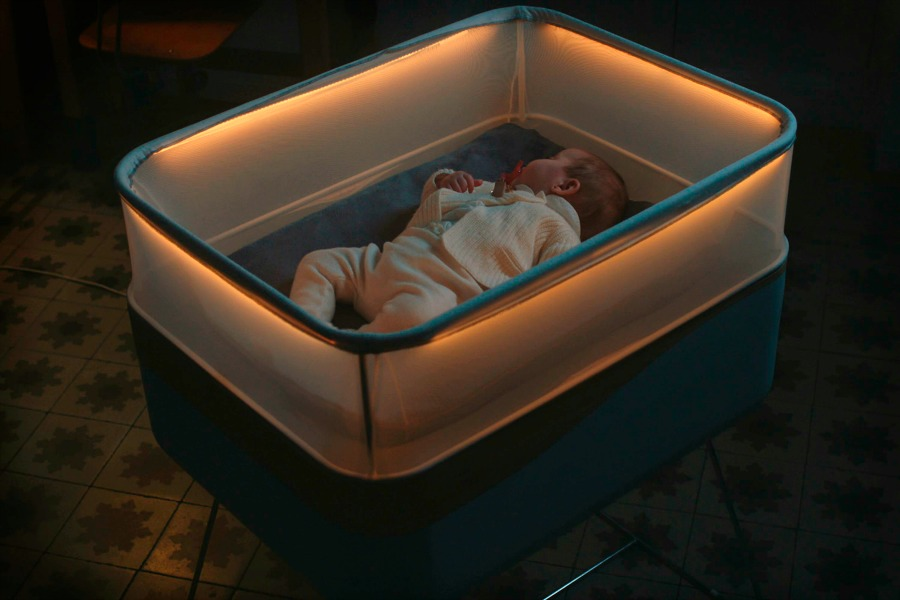 This high-tech baby cot from Ford makes it feel like you're driving your baby around at night.