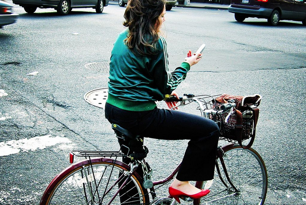 woman reading phone | by flickr user Mo Riza
