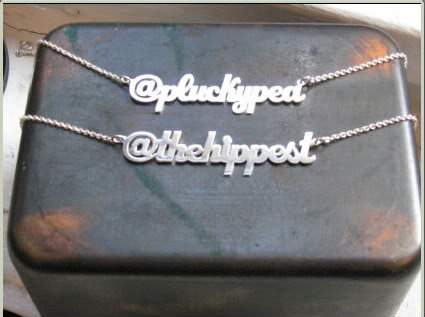 Twitter handle necklaces = Status symbols for the uber geek. Oh yeah.