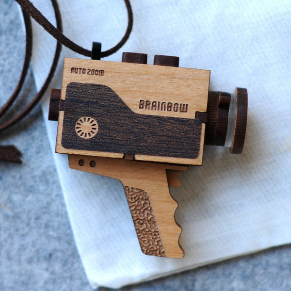 Cool wooden necklaces: Super 8 video camera necklace on Cool Mom Tech