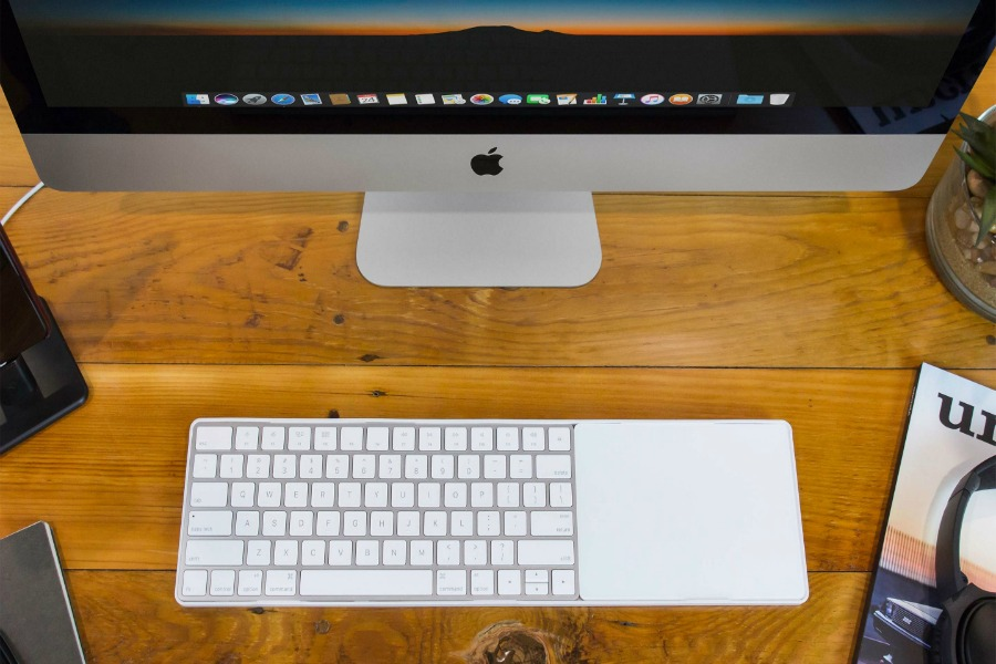 The MagicBridge brings your wireless keyboard and trackpad together like … magic.