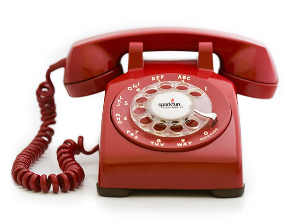 Hold the phone. The gihugic rotary phone, that is.