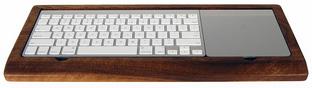 Ambidextrous keyboard tray. AKA paper clip keeper. AKA candy keeper.