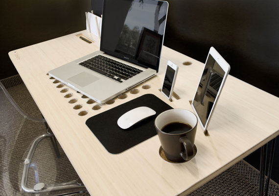 A personal tech desk designed around the idea that not seeing your cords is better than seeing them.