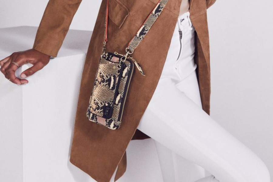 New Bandolier crossbody iPhone holder with pouch in a limited edition snake skin print