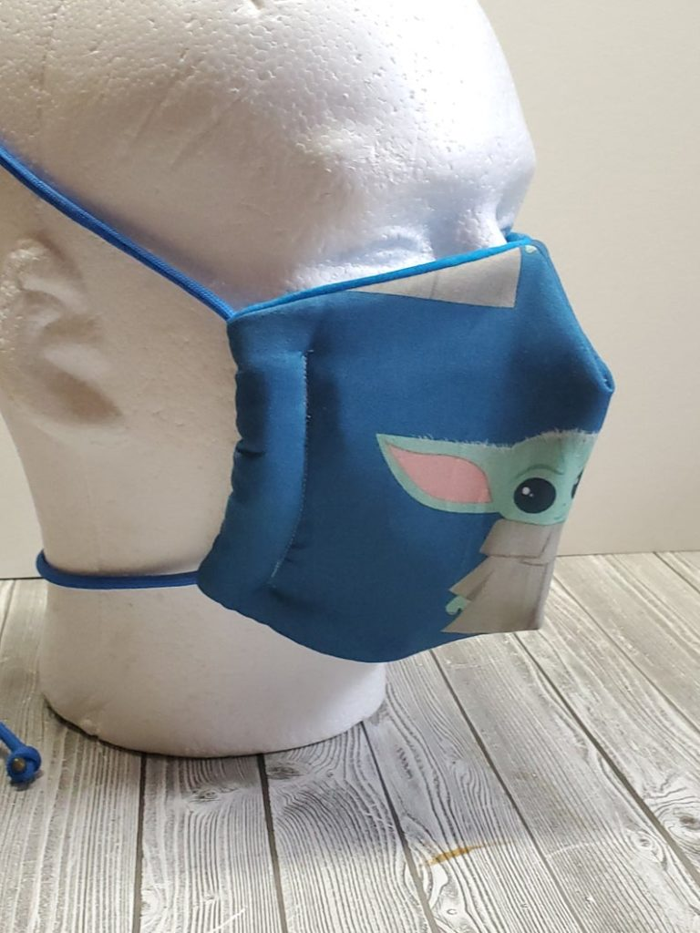 This Baby Yoda face mask from Nerdy Bird Co. comes with adjustable pull-ties for extra comfort.